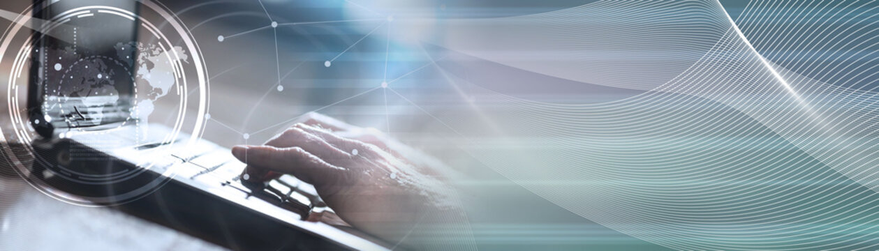 Hands using a laptop, hard light effect, overlayed with graph. panoramic banner