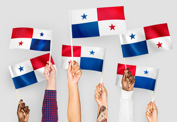 Hands waving the flags of Panama