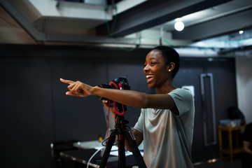 Cheerful photographer giving instructions in the studio