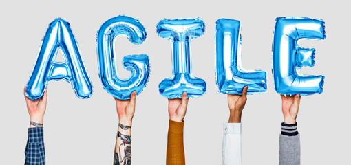 Hands holding agile word in balloon letters