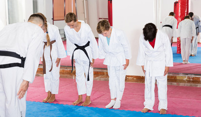 Children greeting karate coach