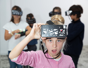 Children play virtual quest room
