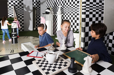 kids  play in lost room in chess style