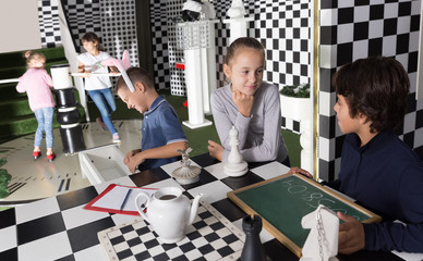 children look for a way out inin quest room in chess style