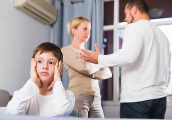 Sad boy during parents quarrel