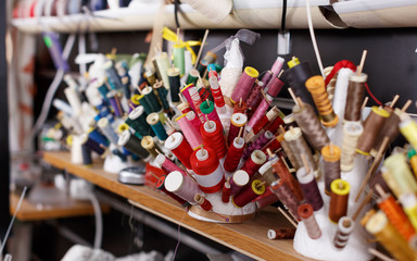 Spools of thread and laces at sewing atelier