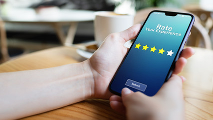 Rate your experience customer satisfaction review Five Stars on mobile phone screen. Business technology concept.