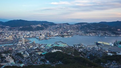 Wall Mural - Nagasaki city skyline day to night time lapse in Japan.