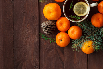 Christmas new year background with tangerines, tea and sweets on the table. winter still. selective focus. copy space