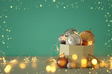 Image of christmas festive tree gold, silver and white balls decoration in the gift box.