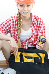 Woman constructive worker with tool bag