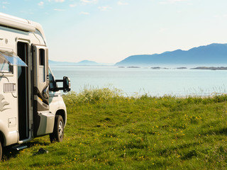 Camper van on sea shore, Lofoten Norway