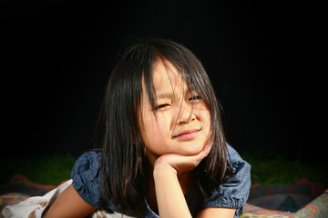 Portrait of a young cute girl looking at the camera