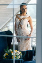 portrait of a bride with a beautiful hair and beautiful make-up in a white dress