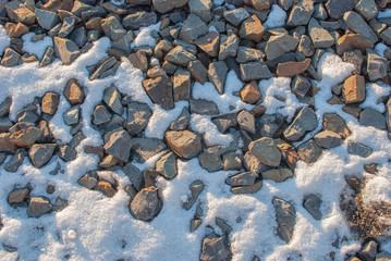 Sunshine on the gravel in the snow