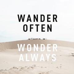 "Inspirational motivational quote ""wander often, wonder always"" on desert background."