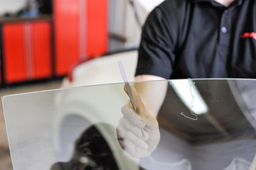 Filing windows . Professional car window tinting services.