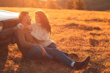 Portrait of beautiful young couple enjoying time together outdoor.