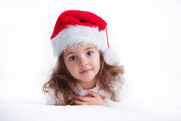 Christmas time, little girl in Santa Claus hat smilling