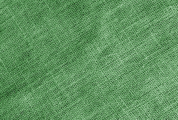 Linen cloth texture in green color.