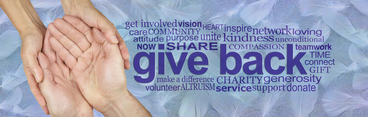 Be an Angel and Give Back - female hands gently cupped around male cupped hands beside a GIVE BACK word cloud against a wide blue banner of random fluffy white feathers