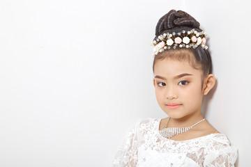 Asian cute young girl wearing a crown