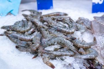 Jumbo prawns on ice on seafood display at the supermarket