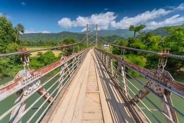 Wooden bridge over Nam Song river near Vang Vieng, Laos.