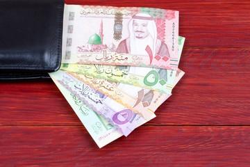 Money from Saudi Arabia in the black wallet