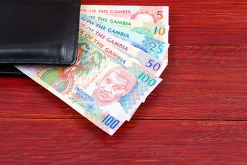 Gambian money in the black wallet