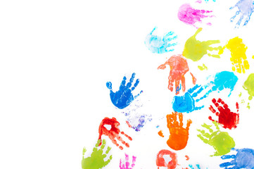 Colored kids handprints on white background with copy space