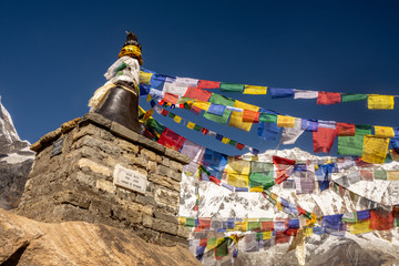 Tibetan prayer colorful flags and Annapurna snowcapped mountain as background, Himalayas