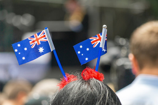 Australian flag waving upon the head of young woman during the Australian day in Sydney Australia