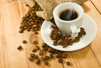 image of a cup of coffee and coffee beans