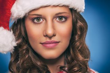 Pretty woman  wearing Santa Claus hat