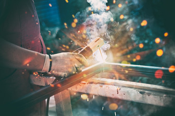 Professional welder welding steel bars