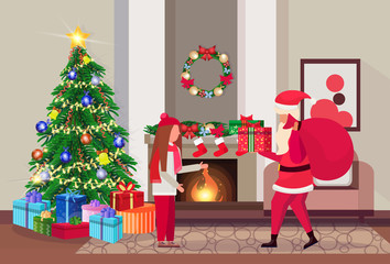santa claus hold present for girl in living room decorated merry christmas happy new year pine tree fireplace home interior decoration winter holiday concept flat horizontal