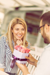 Cute young girl receiving bouquet of roses
