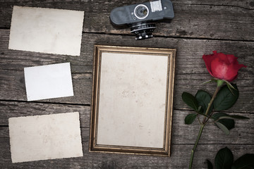 Vintage camera with rose flowers on old wood background