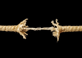 Piece of frayed rope about to break