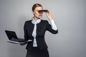 Girl in a suit looking through binoculars