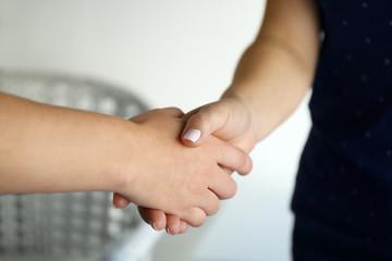 People shaking hands indoors