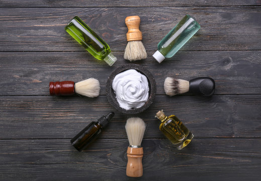 Shaving accessories on wooden background, flat lay