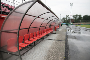 Football bench or seat at sports stadium. Horizontal photo. Selective focusing.