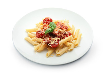 Plate with tasty penne pasta on white background