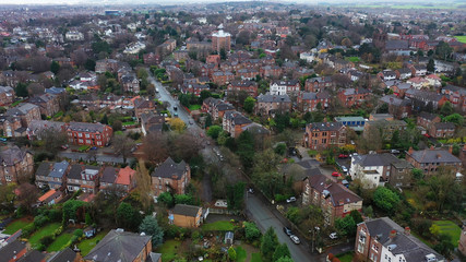 Aerial view over suburban homes and roads in Birkenhead, UK