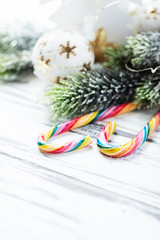 Christmas decoration with sugar candy on white table, selective focus