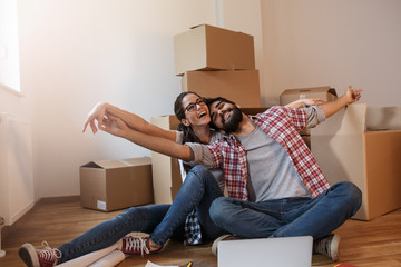 Young couple moving into a new house.