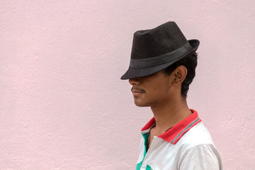 Portrait of young man in hat