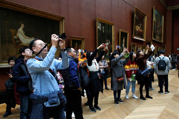 Tourists at the Louvre Museum in Paris